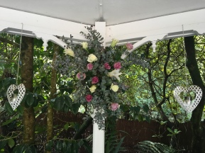 wedding gazebo statement flowers roses and lilies