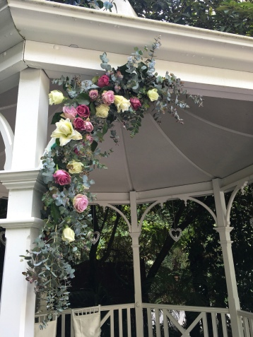 rose and lily wedding arch mill park florist