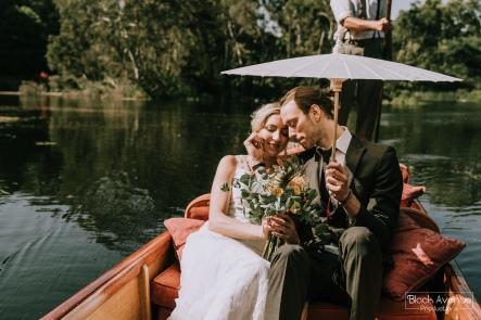 romantic punting wedding bride and groom flowers