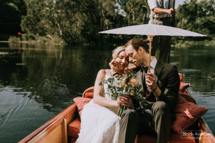 romantic punting wedding bride and groom flowers