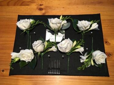 buttonholes for the boys groomsmen