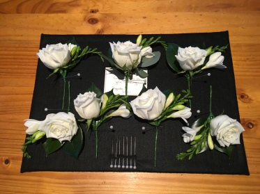 buttonholes for the boys groomsmen