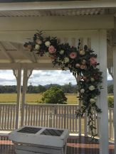 wedding ceremony arch flowers roses