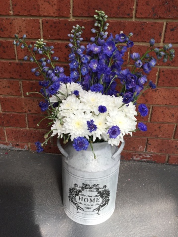 rustic styling milk churn with flowers