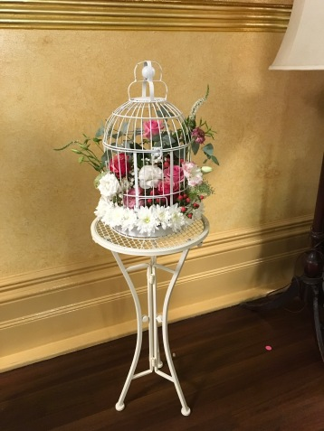 birdcage flowers on wrought iron table