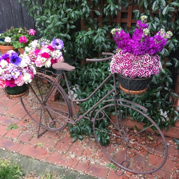 rustic wedding bicycle prop with flowers