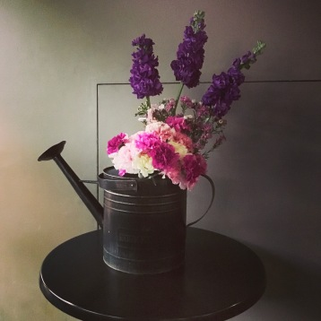 rustic watering can flowers