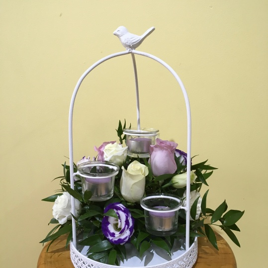 vintage birdcage table centrepiece purple and white flowers