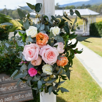 portico arch entrance flowers pastel roses vintage wedding flowers