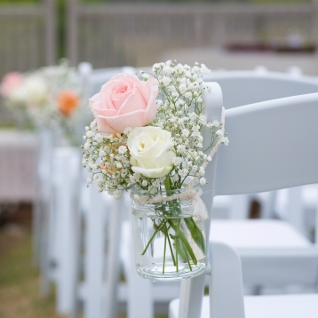 rustic winery wedding ceremony chair flowers pastel roses