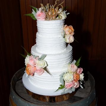 rustic wedding cake pastel flowers roses