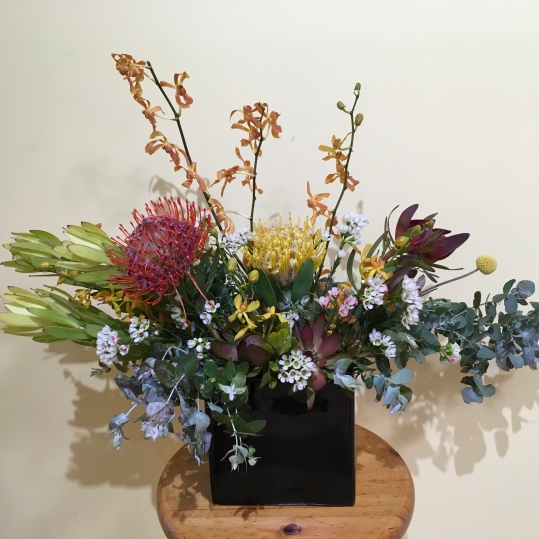 small native flower arrangement corporate flowers mill park florist